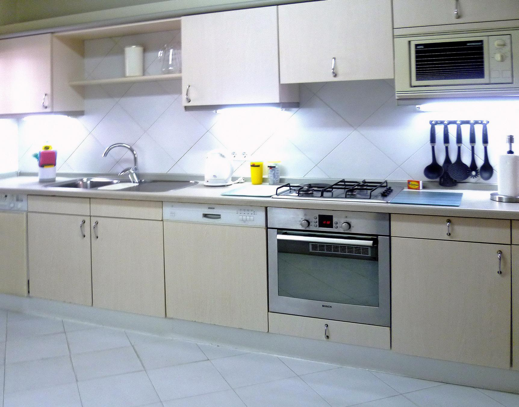 features fridge-freezer, dishwasher, washing machine, oven and hob ...